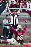FSU running back James Wilder Jr looks to field judge Chris Junjulas for the acknowledgment of his touchdown to make the score 21-0 in a game that saw the Florida State Seminoles defeat the Boston College Eagles 51-7 in their NCAA football game in Tallahassee, FL  Oct. 13, 2012.