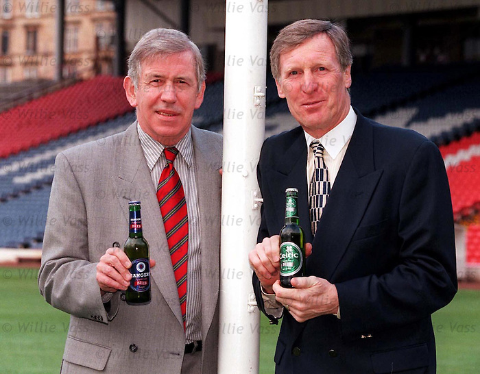 Cheers boys..  Old captains and rivals John Greig and Billy McNeill at Hampden sharing a beer