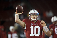 Stanford, CA - November 26, 2016: Keller Chryst throws the ball along the sidelines during the Stanford vs Rice game Saturday at Stanford Stadium.<br /> <br /> Stanford won 41- 17.