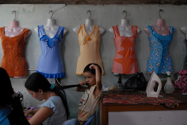 Women make dresses in their home in Can Tho, Vietnam.