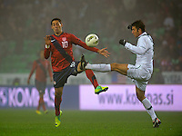 Clint Dempsey (left) of team USA , against Bostjan Cesar (r, SLO) during the friendly match Slovenia against USA at the Stozice Stadium in Ljubljana, Slovenia on November 15th, 2011.