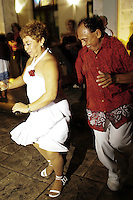 A couple enjoy themselves dancing on a Sunday evening in the Plaza Grande in Merida's center.  They were dancing on the streets to a live performance of the Sonora Santanera.
