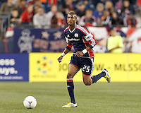 New England Revolution defender Darrius Barnes (25) brings the ball forward. Despite a red-card man advantage, in a Major League Soccer (MLS) match, the New England Revolution tied New York Red Bulls, 1-1, at Gillette Stadium on September 22, 2012.