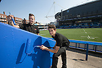 Redrow Homes staff members Luke Andrews<br /> Connor James helping paint Cardiff Arms Park<br /> <br /> 10.09.14<br /> &copy;Steve Pope-SPORTINGWALES