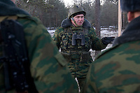 Kamenka, Karelia, Russia, 14/12/2007..A Russian officer briefs his men during Snezhinka [Snowflake] 2007, a joint live fire training exercise for Russian and Swedish motorised infantry in which they play the roles of a combined peace-keeping force enforcing a demilitarised zone in a warring region.