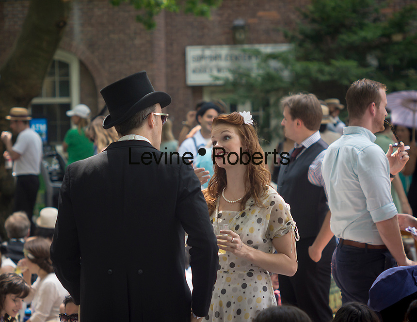 Participants dress up in costume for the 8th Bi-Annual Jazz Age Lawn Party on Governor's Island in New York on Saturday, August 17, 2013. The event, organized by Michael Arenella and his Dreamland Orchestra, attracts hundreds of people costumed in their finest prohibition era clothing.  (© Richard B. Levine)