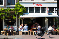 Locals and tourists dining at bar restaurant Cafe Proust in the Noordermarkt - Northern Market  area of Jordaan, Amsterdam