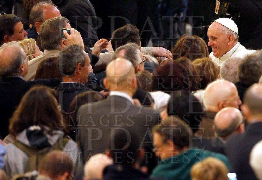 Papa Francesco saluta i fedeli al termine della veglia di preghiera per le vittime innocenti della mafia nella parrocchia di San Gregorio VII a Roma, 21 marzo 2014.<br /> Pope Francis greets faithful at the end of a vigil prayer for innocent victims of mafia, at the parish church of San Gregorio VII in Rome, 21 March 2014.<br /> UPDATE IMAGES PRESS/Riccardo De Luca<br /> <br /> STRICTLY ONLY FOR EDITORIAL USE