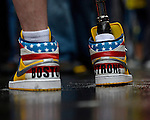 J.P. Norden's sneakers with the phrase Boston Strong, are seen after he and his brother Paul Norden, crossed the Boston Marathon finish line in Boston, on Tuesday, April 15, 2014. The brothers, each of whom lost his right leg in the 2013 Marathon bombings, traveled the 26.2 miles of the marathon route Tuesday as a fundraiser. Photo by Christopher Evans
