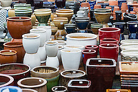 Selection of decorative containers at a garden center.