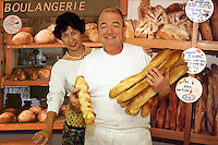 France, Provence.  Traditional French baker and his wife, partners in their boulangerie..