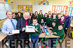 Daniel Hayes Kilgobnet NS is presented his prize for winning  the Haven National  Art competition by Artist Don Conroy and Diarmuid O Sullivan Haven Killorglin in the school on Monday