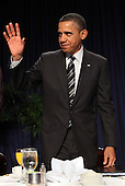United States President Barack Obama waves after speaking at the National Prayer Breakfast in Washington, DC, February 2, 2012. .Credit: Chris Kleponis / Pool via CNP