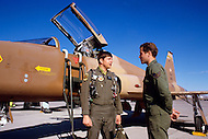 Nellis Air Force Base, Nevada - December 4, 1984. Pilots commence training in a F-16C Fighting Falcon at the U.S. Air Force Tactical Fighter Weapons Center. The U.S. Air Force Tactical Fighter Weapons Center, later renamed the U.S. Air Force Warfare Center in 2005, was founded in 1966 and manages advanced pilot training, concentrating in development of weapons systems.