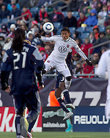 DC United midfielder Andy Najar (14) battle for head ball. In a Major League Soccer (MLS) match, the New England Revolution defeated DC United, 2-1, at Gillette Stadium on March 26, 2011.
