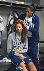 Apr. 5, 2014; Kristina Nelson braids Diamond Thompson's hair in the locker room before practice at the Bridgestone Arena in Nashville, Tenn. Notre Dame square off against Maryland Terrapins Sunday night in the national semifinal of the NCAA Final Four tournament.  Photo by Barbara Johnston/University of Notre Dame