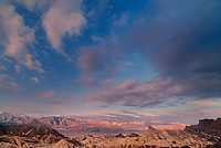 739650048 sunrise over the colored sandstone formations at zabriski point in death valley national park californai