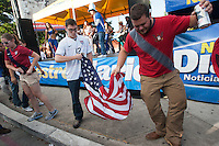 USA fans dance with Guatemalan fans before the United States played Guatemala at Estadio Mateo Flores in Guatemala City, Guatemala in a World Cup Qualifier on Tue. June 12, 2012.