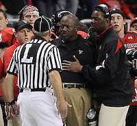 Texas Tech head coach Ruffin McNeill argues with an official during the second half of the Valero Alamo Bowl, Saturday, Jan. 2, 2010, at the Alamodome in San Antonio. Texas Tech won 41-31. (Darren Abate/pressphotointl.com)