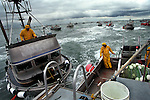 Two 32 foot aluminum fishing boats nearly collide during a salmon opener off the mouth of the Egigik river in Bristol Bay, Alaska.