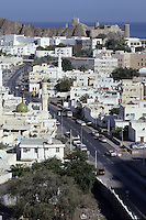 Muscat, Oman.  Fort Mirani, built by the Portuguese in the 16th. century, overlooks the city, whose rooftops are dotted with satellite dishes linking Oman to a 21st. century global communications network.