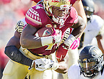 Florida State running back Dalvin Cook drags Wake Forest linebacker Thomas Brown in the first half of an NCAA college football game in Tallahassee, Fla., Saturday, Oct. 15, 2016. Florida State defeated Wake Forest 17-6. (AP Photo/Mark Wallheiser)