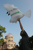 On eve of 60th anniversary of the atomic bombing of Hiroshima Greenpeace flew Peace Doves (bearing messages of peace on their feathers) beside the A-Bomb Dome Memorial in Hiroshima. Greenpeace renewed their calls for peace and renew their call to world leaders to make real their commitments to nuclear disarmament, and for the Japanese government to abandon plans to produce nuclear weapons usable materials. Hiroshima, Japan, 5th August 2005.