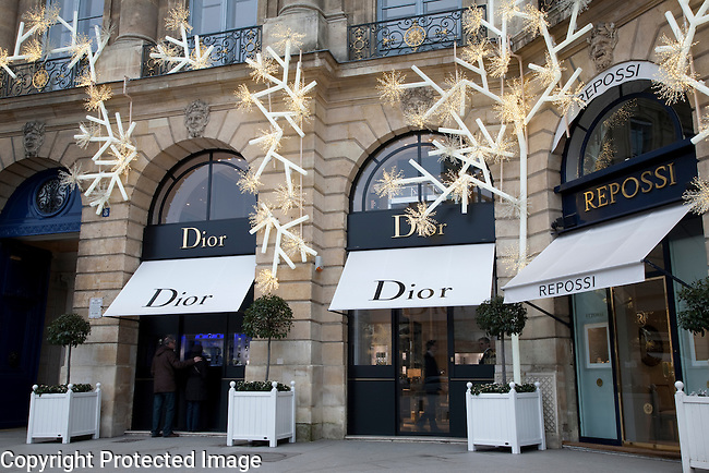 Dior and Repossi Shops in Place Vendome Square decorated for Christmas in Paris, France