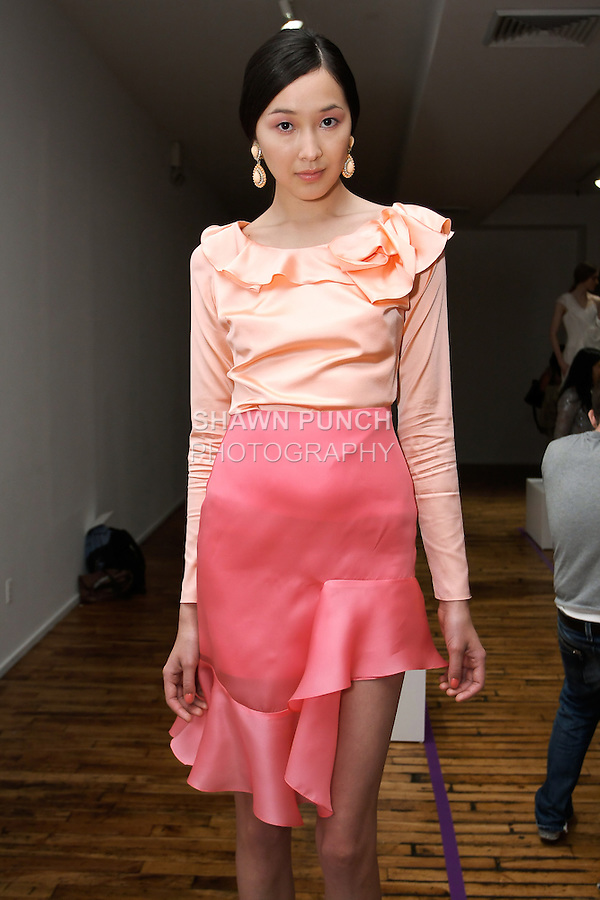 Model poses in an outfit from the Yuna Yang Spring Summer 2012 Magic collection, during New York Fashion Spring 2012, on September 7, 2012.