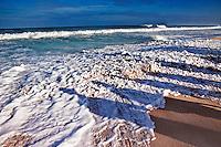 Shadows on the beach of people watching the beautiful seascape atBanzai Pipeline,Ehukai Beach Parkon the North Shore of Oahu, Hawaii.