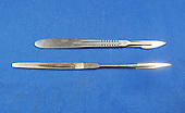 A number 23 blade scalpel on a number 4 handle (above) compared to an 11 blade, 3 handle scalpel (below), both of which are used to make the initial incisions in the skin. Royalty Free