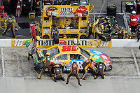 30 March - 1 April, 2012, Martinsville, Virginia USA.Kyle Busch, M&M's Toyota Camry and crew pit road pit stop.(c)2012, Scott LePage.LAT Photo USA