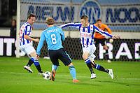 VOETBAL: HEERENVEEN: Abe Lenstra Stadion, SC Heerenveen - Ajax, 11-01-2012, Eindstand 0-5, Christian Eriksen (#8), Jeffrey Gouweleeuw (#3), ©foto Martin de Jong