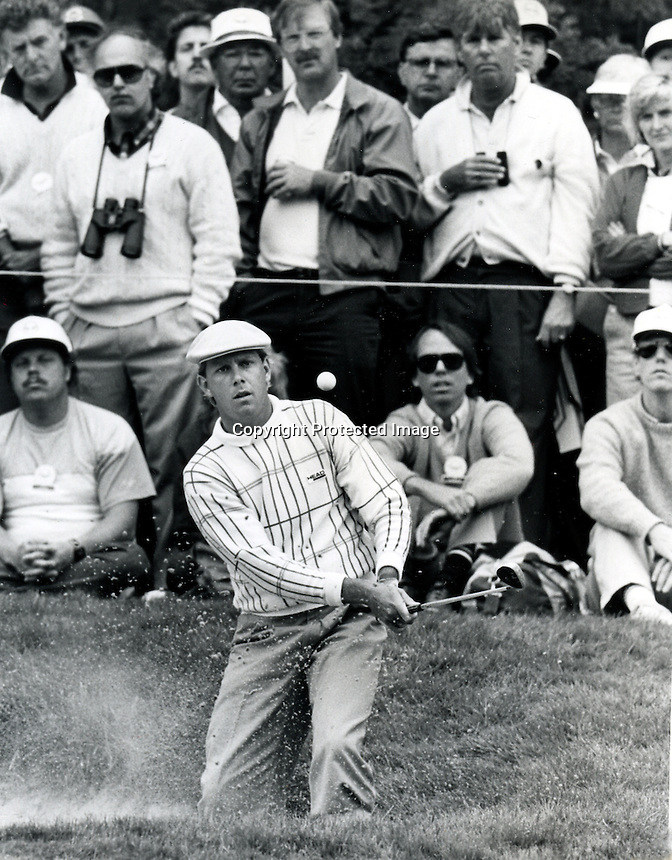 Paine Stewart blasts out of the bunker on the 17th hole at the Olympic Club in San Francisco during the 1987 U.S. Open. (photo copyright Ron Riesterer)
