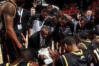 CHARLOTTESVILLE, VA- DECEMBER 6: Head coach Paul Hewitt of the George Mason Patriots talks with his player inside the huddle before the start of the game on December 6, 2011against the Virginia Cavaliers at the John Paul Jones Arena in Charlottesville, Virginia. Virginia defeated George Mason 68-48. (Photo by Andrew Shurtleff/Getty Images) *** Local Caption *** Paul Hewitt