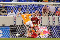 Richard Mulrooney (8) of the Houston Dynamo fouls John Wolyniec (15) of the New York Red Bulls setting up a free kick. The New York Red Bulls defeated the Houston Dynamo 2-1 during a Major League Soccer (MLS) match at Red Bull Arena in Harrison, NJ, on June 2, 2010.