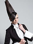 Fashion photo of a beautiful woman with a bizarre creative hairstyle