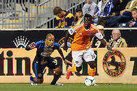 Jason Johnson (14) of the Houston Dynamo. The Houston Dynamo defeated the Philadelphia Union 1-0 during a Major League Soccer (MLS) match at PPL Park in Chester, PA, on September 14, 2013.