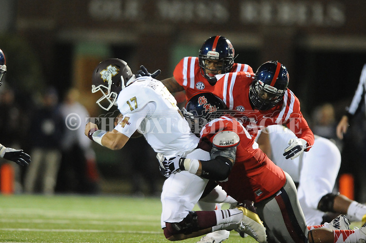 Ole Miss defensive tackle Gilbert Pena (99) tackles Mississippi State quarterback Tyler Russell (17) at Vaught Hemingway Stadium in Oxford, Miss. on Saturday, November 24, 2012. Ole Miss won 41-24.