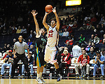 Mississippi's Marshall Henderson (22) shoots against Coastal Carolina's Anthony Raffa (2) at the C.M. &quot;Tad&quot; Smith Coliseum in Oxford, Miss. on Tuesday, November 13, 2012. (AP Photo/Oxford Eagle, Bruce Newman)