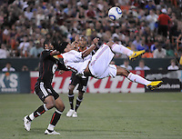 AC Milan forward Ronaldinho (80) goes up for a bicycle kick . DC United defeated AC. Milan 3-2 at RFK Stadium, Wednesday May 26, 2010.