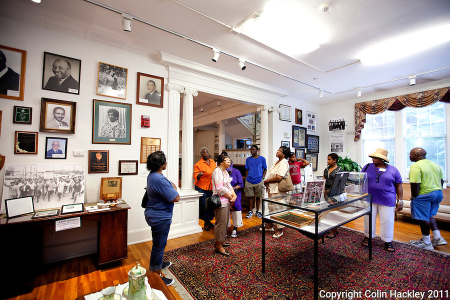 POLITICALLY ACTIVE: Robinson family reunion members tour the room celebrating prominent African American politicians at The Black Archives in Tallahassee..COLIN HACKLEY PHOTO