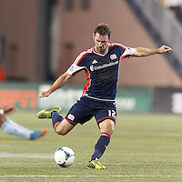 New England Revolution midfielder Andy Dorman (12) passes the ball.  In the first game of two-game aggregate total goals Major League Soccer (MLS) Eastern Conference Semifinal series, New England Revolution (dark blue) vs Sporting Kansas City (light blue), 2-1, at Gillette Stadium on November 2, 2013.