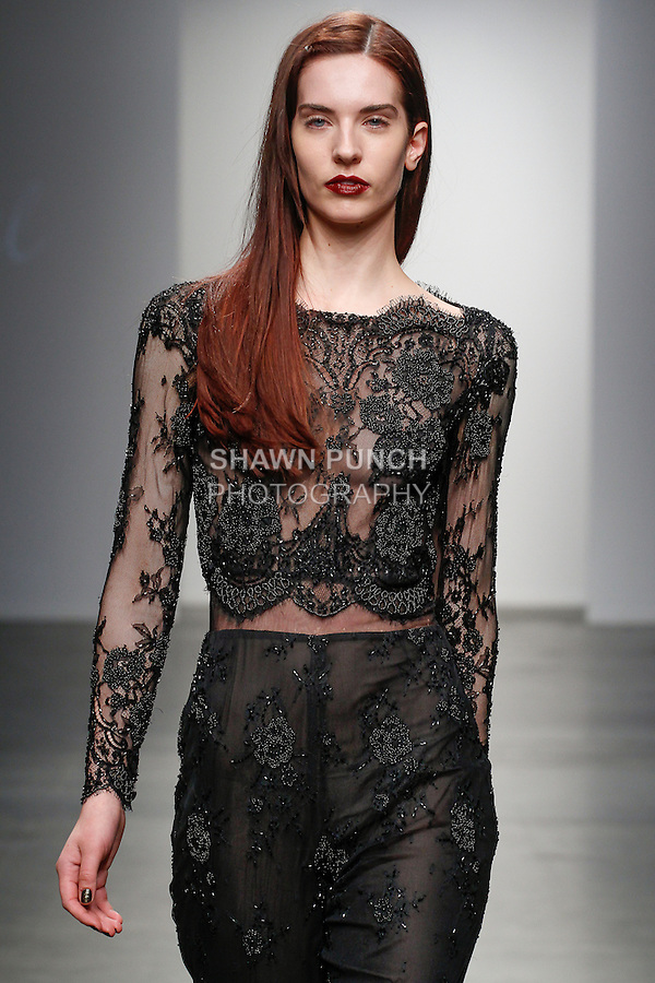 Model walks runway in an outfit from the Steven Khalil Fall 2014 collection, at Fashion Palette New York Fall Winter 2014/2015; during New York Fashion Week Fall 2014, on February 11, 2014.