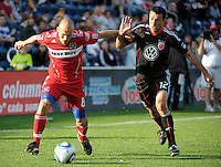 Chicago midfielder Freddie Ljungberg (8) battles for the ball with DC United defender Jed Zayner (12).  The Chicago Fire tied DC United 0-0 at Toyota Park in Bridgeview, IL on Oct. 16, 2010.