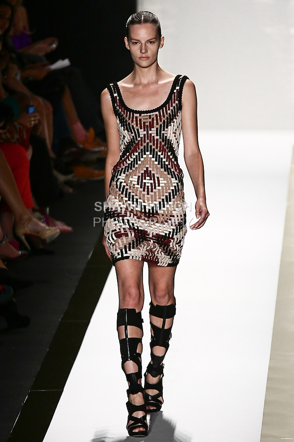 Sara Blomqvist walks the runway in a multi basket weave bandage dress, and black gladiator boot, by Max Azria for the Herve Leger by Max Azria Spring 2012 fashion show, during Mercedes-Benz Fashion Week Spring 2012.