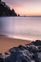 Sun rises on golden beach in Totaranui, Abel Tasman National Park, Nelson Region, New Zealand
