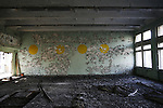 RADIOACTIVITY CHERNOBYL, Exclusion zone. Ukraine. School. Pripyat town. Evacuated in 3 hours shortly after  the  reactor fire. The town was buildt only  15 years before. Eve of the 20th Anniversary of the fire in reactor 4 at Chernobyl power station in 1986. The fire started in the early hours of the 26th April 1986, The radioactive cloud  dispersed  worldwide. 250 thousand were evacuated. Exclusion zones exist in close vicinity of Chernobyl in Ukraine and Belarus where people will not be able to live for tens of thousands of years.