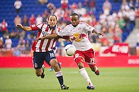 Dane Richards (19) of the New York Red Bulls is defended by Nick LaBrocca (10) of CD Chivas USA during the first half of a Major League Soccer (MLS) match at Red Bull Arena in Harrison, NJ, on May 23, 2012.