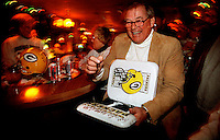Former Green Bay Packers guard Jerry Kramer signs autographs at Fuzzy Thurston's bar in Green Bay during the 1996-97 playoffs.